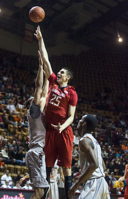 Feb 7, 2013; Blacksburg, VA, USA; Maryland Terrapins center Alex Len (25) shoots the ball over Virginia Tech Hokies forward Joey Van Zegeren (2) during the first half at Cassell Coliseum. Mandatory Credit: Peter Casey-USA TODAY Sports