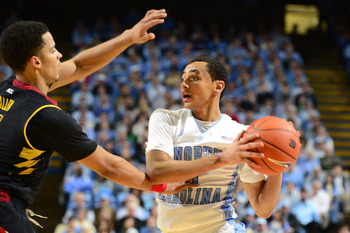 Jan 19, 2013; Chapel Hill, NC, USA; North Carolina Tar Heels guard Marcus Paige (5) with the ball as Maryland Terrapins guard Seth Allen (4) defends in the second half. The Tar Heels defeated the Terrapins 62-52 at the Dean E. Smith Center. Mandatory Cred