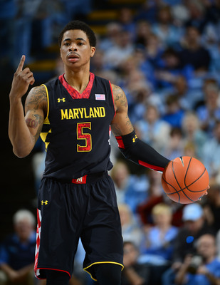 Jan 19, 2013; Chapel Hill, NC, USA; Maryland Terrapins guard Nick Faust (5) dribbles in the first half. The Tar Heels defeated the Terrapins 62-52 at the Dean E. Smith Center. Mandatory Credit: Bob Donnan-USA TODAY Sports