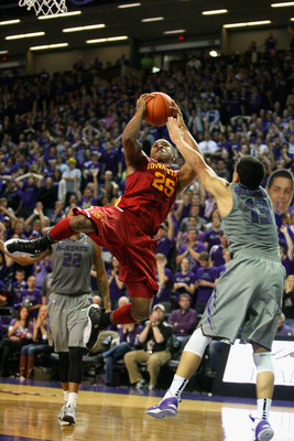 Feb 9, 2013; Manhattan, KS, USA; Iowa State Cyclones guard Tyrus McGee (25) shoots as Kansas State Wildcats guard Angel Rodriguez (13) defends during the game at Bramlage Coliseum. Wildcats won 79-70. Mandatory Credit: Scott Sewell-USA TODAY Sports