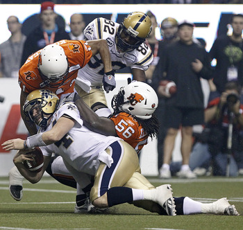 Elimimian, No. 56, in the thick of things during the 2011 Grey Cup final.