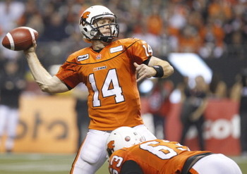 Jovan Olafioye at the feet of quarterback Travis Lulay during the 2011 Grey Cup championship.