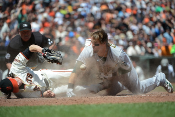 Cowgill fearlessly collides head-first with San Francisco Giants star pitcher Tim Lincecum attempting to score on a wild pitch.