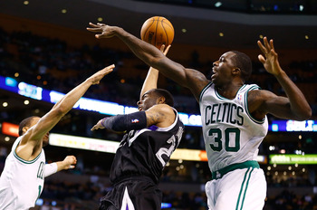 BOSTON, MA - JANUARY 30: Marcus Thornton #23 of the Sacramento Kings puts up a shot in front of Brandon Bass #30 of the Boston Celtics during the game on January 30, 2013 at TD Garden in Boston, Massachusetts. NOTE TO USER: User expressly acknowledges and