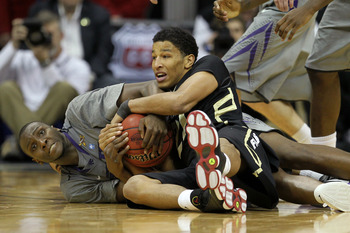 Andre Roberson (right) is second in the nation in rebounding
