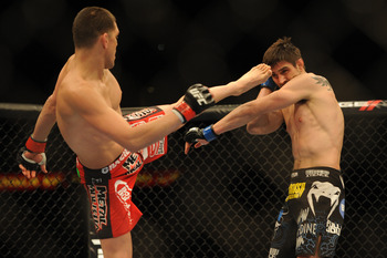 February 4, 2012; Las Vegas, NV, USA; UFC fighter Carlos Condit (right) fights against Nick Diaz (left) during UFC 143 at the Mandalay Bay Events Center. Carlos Codit defeated Nick Diaz. Mandatory Credit: Kelvin Kuo-USA TODAY Sports