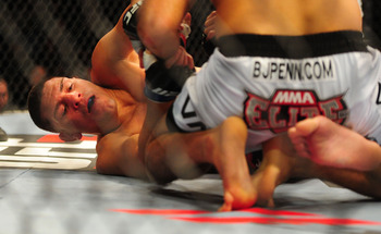 Oct. 29, 2011; Las Vegas, NV, USA; UFC fighter Nick Diaz (left) during a welterweight bout against fighter B.J. Penn during UFC 137 at the Mandalay Bay event center. Mandatory Credit: Mark J. Rebilas-USA TODAY Sports