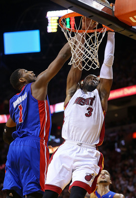 MIAMI, FL - JANUARY 25: Dwyane Wade #3 of the Miami Heat is fouled by Andre Drummond #1 of the Detroit Pistons during a game  at American Airlines Arena on January 25, 2013 in Miami, Florida.  (Photo by Mike Ehrmann/Getty Images)