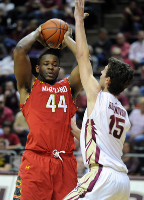 Jan 30, 2013; Tallahassee, FL, USA; Maryland Terrapins center Shaquille Cleare (44) tries to pass the ball as he is defended by Florida State Seminoles center Boris Bojanovsky (15) during the first half of the game at the Donald L. Tucker Center.  Mandato