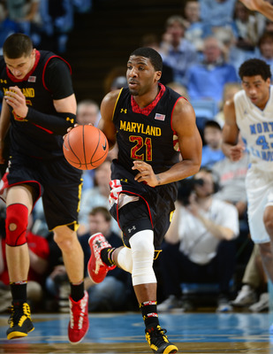 Jan 19, 2013; Chapel Hill, NC, USA; Maryland Terrapins guard Pe'Shon Howard (21) dribbles in the first half. The Tar Heels defeated the Terrapins 62-52 at the Dean E. Smith Center. Mandatory Credit: Bob Donnan-USA TODAY Sports