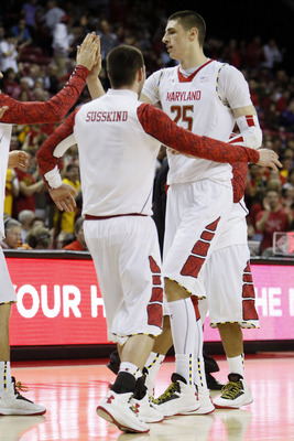 Feb 2, 2013; College Park, MD, USA; Maryland Terrapins center Alex Len (25) is congratulated following his dunk basket against the Wake Forest Demon Deacons at Comcast Center. Mandatory Credit: Mitch Stringer-USA TODAY Sports