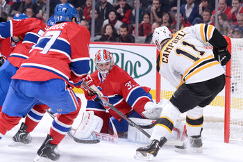 Montreal Canadien Carey Price makes a save on Boston Bruin Gregory Campbell.