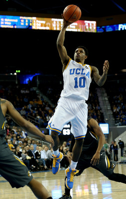 LOS ANGELES, CA - DECEMBER 28:  Larry Drew II #10 of the UCLA Bruins shoots against the Missouri Tigers at Pauley Pavilion on December 28, 2012 in Los Angeles, California.  UCLA won 97-94 in overtime.  (Photo by Stephen Dunn/Getty Images)