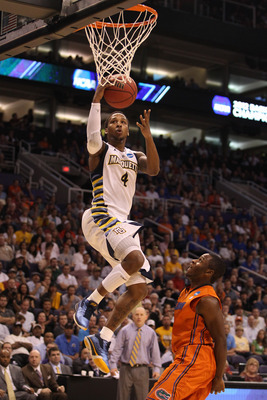 PHOENIX, AZ - MARCH 22:  Todd Mayo #4 of the Marquette Golden Eagles lays the ball up against the Florida Gators during the 2012 NCAA Men's Basketball West Regional Semifinal game at US Airways Center on March 22, 2012 in Phoenix, Arizona.  (Photo by Chri