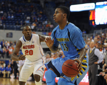 GAINESVILLE, FL - NOVEMBER 29:  Guard Vander Blue #13 of the  Marquette Golden Eagles looks for a basket against the Florida Gators November 29, 2012 at Stephen C. O'Connell Center in Gainesville, Florida. Florida won 82 - 49. (Photo by Al Messerschmidt/G