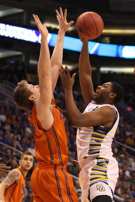 PHOENIX, AZ - MARCH 22:  Davante Gardner #54 of the Marquette Golden Eagles shoots over Erik Murphy #33 of the Florida Gators during the 2012 NCAA Men's Basketball West Regional Semifinal game at US Airways Center on March 22, 2012 in Phoenix, Arizona.  (