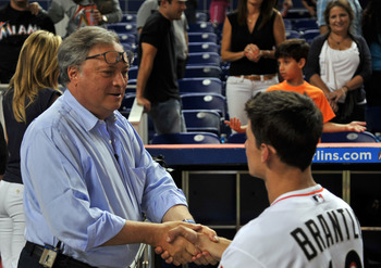 Aug 14, 2012; Miami, FL, USA; Miami Marlins owner Jeffrey Loria (left) shakes hands with catcher Rob Brantly (right) after their game against the Philadelphia Phillies at Marlins Park. The Phillies won 1-0. Mandatory Credit: Steve Mitchell-USA TODAY Sport