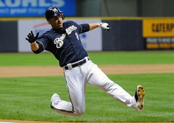 Oct 1, 2012; Milwaukee, WI, USA;   Milwaukee Brewers left fielder Ryan Braun (8) scores on a single by third baseman Aramis Ramirez (16) (not pictured) in the first inning during the game against the San Diego Padres at Miller Park.  Mandatory Credit: Ben