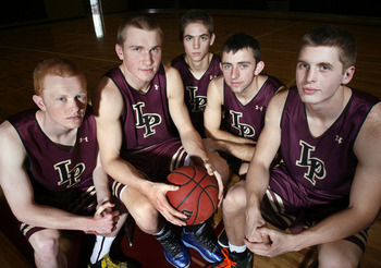 TJ Haws, Eric Mika and Nick Emery of Lone Peak HS are all BYU commits. (Photo via sltrib.com)
