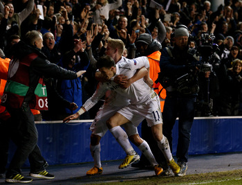 A delighted Lewis Holtby is the first to congratulate Bale on his winner.