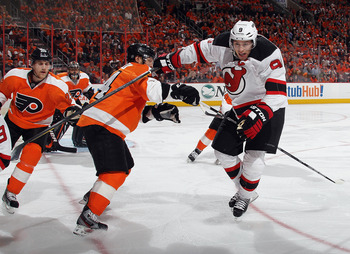 Zach Parise skates past a Flyer in a series New Jersey dominated