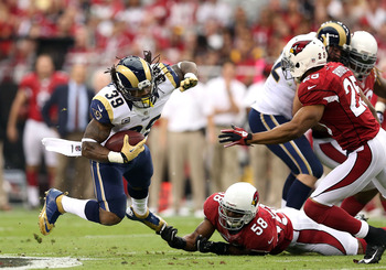 Washington (bottom) trips up Steven Jackson of the Rams.
