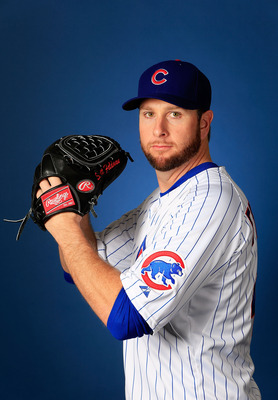 MESA, AZ - FEBRUARY 18:  Pitcher Scott Feldman #46 poses during Chicago Cubs photo day on February 18, 2013 at HoHoKam Park in Mesa, Arizona.  (Photo by Jamie Squire/Getty Images)