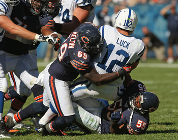 Luck taken down by two Bears after offensive line breakdown
