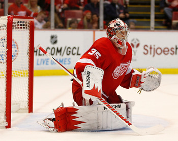 Jimmy Howard of the Detroit Red Wings, poised to stop a puck. One would assume.