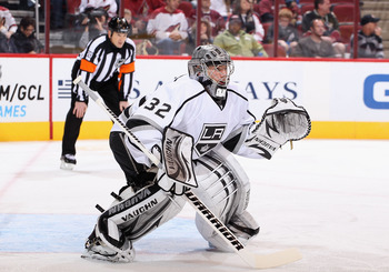 Jonathan Quick readying for a puck while the referee prepares to make a hit-to-the-head call from 90-feet away.