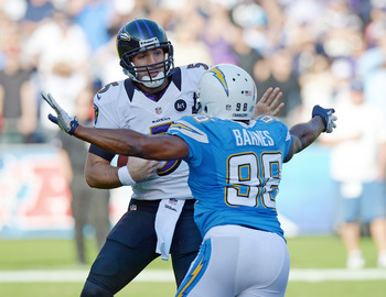 Nov 25, 2012; San Diego, CA, USA; Baltimore Ravens quarterback Joe Flacco (5) is sacked by San Diego Chargers linebacker Antwan Barnes (98) during the second quarter at Qualcomm Stadium. Mandatory Credit: Jake Roth-USA TODAY Sports
