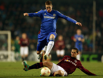 PRAGUE, CZECH REPUBLIC - FEBRUARY 14:  Fernando Torres of Chelsea skips past the challenge of Mario Holek of Sparta Praha during the UEFA Europa League match between AC Sparta Praha and Chelsea on February 14, 2013 in Prague, Czech Republic.  (Photo by Sc