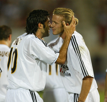 Luis Figo celebrates his goal against Mallorca with David Beckham.