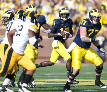 ANN ARBOR, MI - NOVEMBER 17: Devin Gardner #12 of the Michigan Wolverines looks for an open receiver while playing the Iowa Hawkeyes at Michigan Stadium on November 17, 2012 in Ann Arbor, Michigan. (Photo by Gregory Shamus/Getty Images)