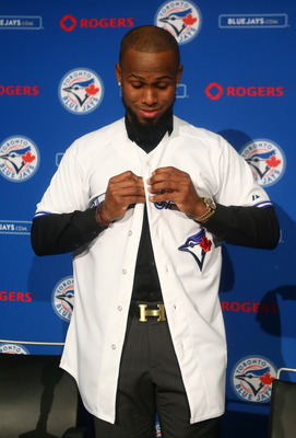 Jose Reyes tries on his new Jays jersey.