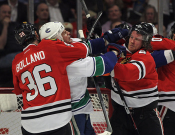 Dave Bolland never hesitates to get hands-on with Vancouver.
