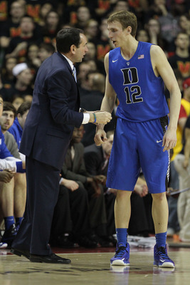 Feb 16, 2013; College Park, MD, USA; Duke Blue Devils head coach Mike Krzyzewski instructs forward Alex Murphy (12) in the final minutes against the Maryland Terrapins at the Comcast Center. Mandatory Credit: Mitch Stringer-USA TODAY Sports