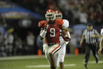 Dec 1, 2012; Atlanta, GA, USA; Georgia Bulldogs linebacker Alec Ogletree (9) returns a blocked field goal 50 yards for a touchdown during the third quarter in the 2012 SEC Championship game at the Georgia Dome. Mandatory Credit:  Dale Zanine-USA TODAY Spo