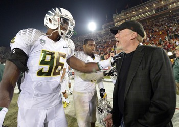Nov 3, 2012; Los Angeles, CA, USA; Oregon Ducks defensive end Dion Jordan (96) shakes hands with Nike co-founder Phil Knight after the game against the Southern California Trojans at the Los Angeles Memorial Coliseum. Oregon defeated USC 62-51. Mandatory