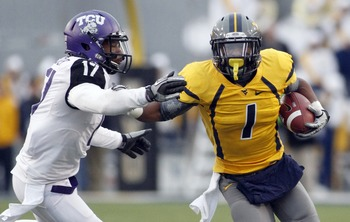MORGANTOWN, WV - NOVEMBER 03:  Tavon Austin #1 of the West Virginia Mountaineers carries the ball against the TCU Horned Frogs during the game on November 3, 2012 at Mountaineer Field in Morgantown, West Virginia.  TCU defeated WVU in two overtimes 39-38.