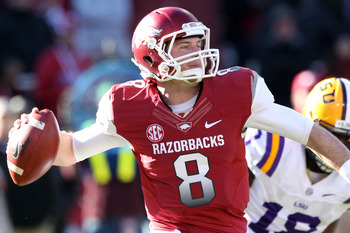 Nov 23, 2012; Fayetteville, AR, USA; Arkansas Razorbacks quarterback Tyler Wilson (8) looks to pass against the LSU Tigers at Donald W. Reynolds Razorback Stadium. Mandatory Credit: Nelson Chenault-USA TODAY Sports