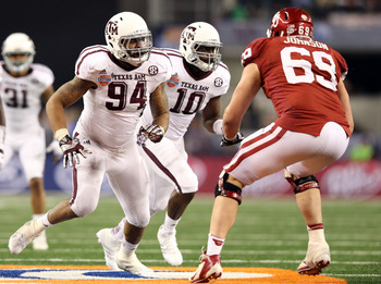 Jan 4, 2013; Arlington, TX, USA; Texas A&M Aggies linebacker Damontre Moore (94) and linebacker Sean Porter (10) runs against Oklahoma Sooners tackle Lane Johnson (69) during the Cotton Bowl at Cowboys Stadium.  Texas A&M beat Oklahoma 41-13. Mandatory Cr