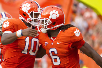 Oct 6, 2012; Clemson, SC, USA; Clemson Tigers quarterback Tajh Boyd (10) celebrates with wide receiver DeAndre Hopkins (6) after a touchdown during the second quarter of  the game against the Georgia Tech Yellow Jackets at Clemson Memorial Stadium. Mandat