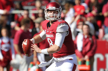 Nov 3, 2012; Fayetteville, AR, USA; Arkansas Razorbacks quarterback Tyler Wilson (8) looks to pass against the Tulsa Golden Hurricanes at Donald W. Reynolds Razorback Stadium. Arkansas defeated Tulsa 19-15. Mandatory Credit: Nelson Chenault-USA TODAY Spor