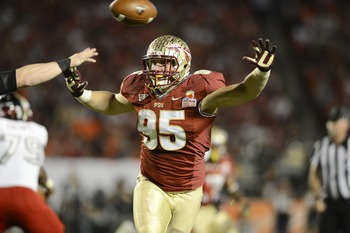 Jan 1, 2013; Miami Gardens, FL, USA; Florida State Seminoles defensive end Bjoern Werner (95) pressures in the second quarter of the game against the Northern Illinois Huskies at the 2013 Orange Bowl at Sun Life Stadium. Mandatory Credit: Ron Chenoy-USA T