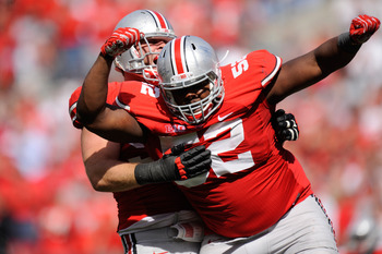 COLUMBUS, OH - SEPTEMBER 15:  Johnathan Hankins #52 of the Ohio State Buckeyes celebrates a sack on quarterback Zach Maynard #15 of the California Golden Bears with teammate Garrett Goebel  #53 at Ohio Stadium on September 15, 2012 in Columbus, Ohio. Ohio