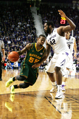 Feb 16, 2013; Manhattan, KS, USA; Baylor Bears guard Pierre Jackson (55) dribbles against Kansas State Wildcats forward Thomas Gipson (42) during the Bears' 81-61 loss at Bramlage Coliseum. Mandatory Credit: Scott Sewell-USA TODAY Sports