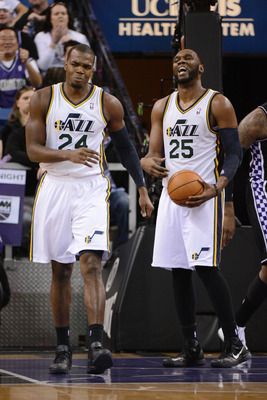 February 9, 2013; Sacramento, CA, USA; Utah Jazz power forward Paul Millsap (24) and center Al Jefferson (25) react after being called for a foul during the third quarter against the Sacramento Kings at Sleep Train Arena. The Kings defeated the Jazz 120-1