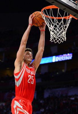 Feb 15, 2013; Houston, TX, USA; Team Shaq forward Chandler Parsons (25) of the Houston Rockets dunks against Team Chuck during the first half of the rising stars challenge during the 2013 NBA All-Star weekend at the Toyota Center. Mandatory Credit: Bob Do