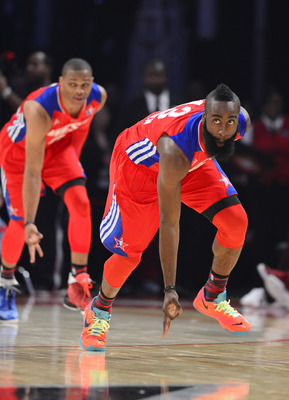 Feb 17, 2013; Houston, TX, USA; Western Conference guard James Harden (right) of the Houston Rockets and guard Russell Westbrook (left) of the Oklahoma City Thunder react after a three pointer in the fourth quarter of the 2013 NBA all star game at the Toy